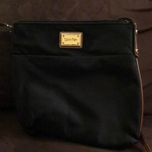 Black bag with brown leather straps